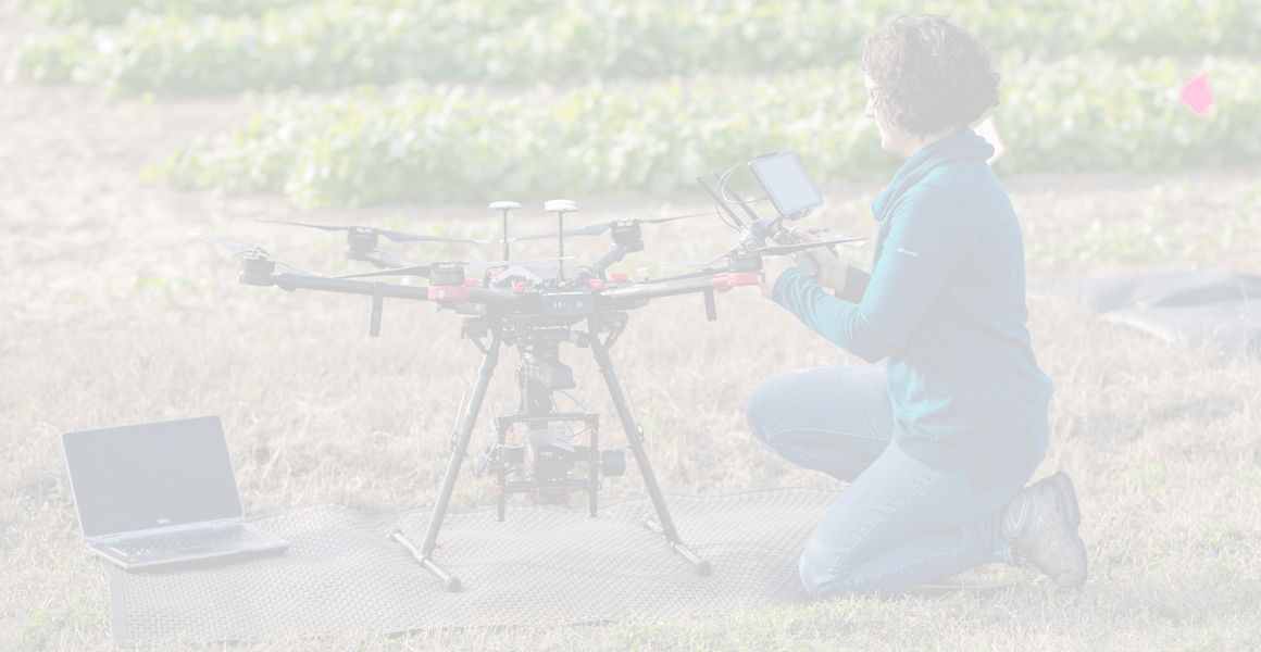 girl in field with drone